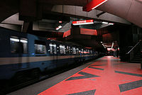 A train departs from Acadie station. The Montreal Metro has 68 stations and four lines.