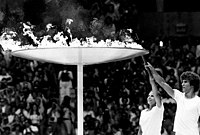 Lighting of the Olympic Torch inside Montreal's Olympic Stadium. The city hosted the 1976 Summer Olympics.