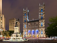 """View of the Notre-Dame Basilica from Place d'Armes. The number of churches in Montreal led it to be called """"the city of a hundred steeples""""."""
