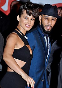 Swizz Beatz with wife Alicia Keys, in Cannes, France, at the NRJ Music Awards ceremony, January 2013