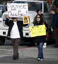 Protesters holding signs on January 8, 2009