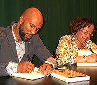 Common and his mother, Dr. Mahalia Ann Hines, at a 2011 signing for his memoir at the Barnes & Noble in Tribeca, Manhattan