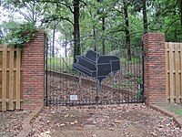 The gate to Lewis' ranch in Nesbit, Mississippi
