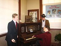 """An exhibit at the Delta Music Museum in Ferriday, Louisiana representing """"Ferriday's Famous Cousins""""; from left to right: Jimmy Swaggart, Lewis and Mickey Gilley"""