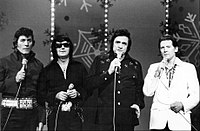 Lewis performing with Carl Perkins, Roy Orbison and Johnny Cash on The Johnny Cash Christmas Special in November 1977