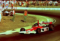 Hunt celebrates at the 1976 British Grand Prix; he would later be disqualified from the results.