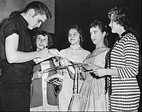 Presley signing autographs in Minneapolis in 1956