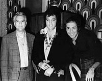 Presley with friends Bill Porter and Paul Anka backstage at the Las Vegas Hilton on August 5, 1972