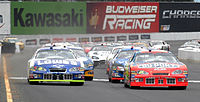 Jeff Gordon and Jimmie Johnson leading the field at the start of the 2005 race
