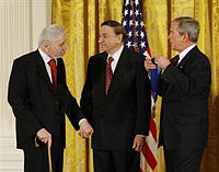 The Sherman Brothers receiving the National Medal of Arts at The White House on November 17, 2008 (left to right: Robert B. Sherman, Richard M. Sherman and U.S. President George W. Bush)