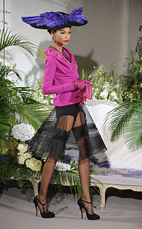 Iman walking for Christian Diors haute couture show in July 2009
