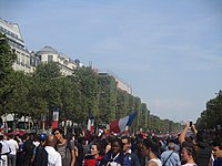 French flags displayed on the Champs Elysées after France's victory at the 2018 FIFA World Cup. The French Tricolore is enshrined in the French Constitution as the national emblem of the French Republic.