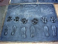Radcliffe, Grint, and Watson were honored outside Grauman's Chinese Theatre at the Hand, Foot, and Wand Ceremony, Hollywood Walk of Fame, July 2007.