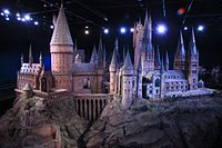 A studio model of Hogwarts. It is the main setting in the series; the castle features in every novel and screen adaptation.