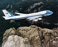 Air Force One, a Boeing VC-25, over Mount Rushmore