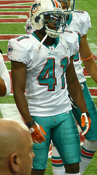Vince Agnew wearing a helmet. Shoulder pads and thigh pads are visible under his uniform