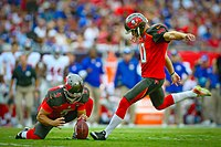 Tampa Bay Buccaneers placekicker Connor Barth attempts a field goal by kicking the ball from the hands of a holder. This is the standard method to score field goals or extra points.