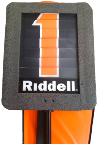 A modern down indicator box is mounted on a pole and is used to mark the current line of scrimmage. The number on the marker is changed using a dial.