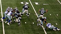Carolina Panthers quarterback Jake Delhomme (number 17) in the motion of throwing a forward pass