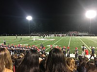 A high school football game during the first quarter
