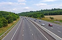 The M4 motorway with Burderop Wood on the right-hand side; the stone circle stood nearby