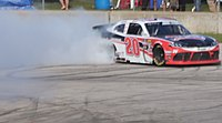 Christopher Bell does a burnout after winning the race