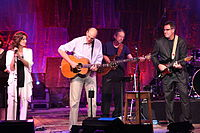 Taylor performing with Vince Gill (right) and Amy Grant (left) at Tanglewood in 2011