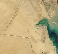 A satellite image of Kuwait reveals its desert topography.