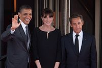Sarkozy and his wife Carla Bruni greet President Barack Obama at the G8 Summit dinner in Deauville, France, 26 May 2011.
