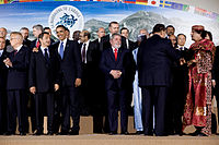Sarkozy (at left) attending the G-8 Summit in 2009
