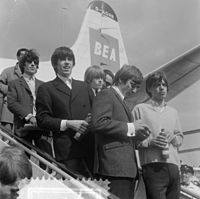 The Rolling Stones at Amsterdam Airport Schiphol, Netherlands in 1964, from back to front: Wyman, Jones, Richards, Watts and Jagger.