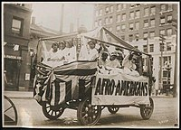 """This parade float displayed the word """"Afro-Americans"""" in 1911."""