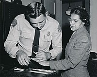 Rosa Parks being fingerprinted after being arrested for not giving up her seat on a bus to a white person