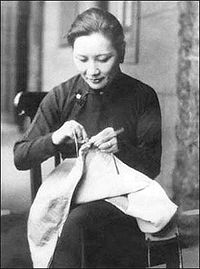Soong stitching uniforms for National Revolutionary Army soldiers.