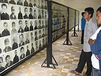 Rooms of the Tuol Sleng Genocide Museum contain thousands of photos taken by the Khmer Rouge of their victims.