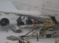 Cargo loading of a Lufthansa Boeing 747-400 during a temporary closure due to heavy snowfall