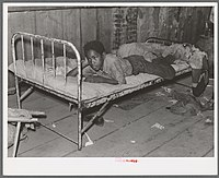 African American boy in a sharecropper shack, New Madrid County, 1938.