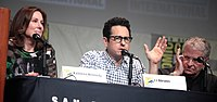 From left to right: producer Kathleen Kennedy, writer and director J. J. Abrams, and writer Lawrence Kasdan speaking at 2015 San Diego Comic-Con