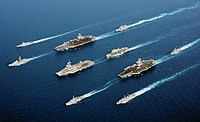 5-country multinational fleet, during Operation Enduring Freedom in the Oman Sea. In four descending columns, from left to right:, ;, , ; , , , ; and.