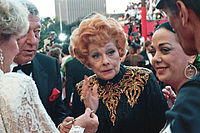 Ball at her last public appearance at the 61st Academy Awards in 1989, four weeks before her death. Ball's husband, Gary Morton, can be seen on the left side of the photograph.