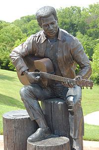 """""""Otis Redding Sittin' on the Dock of the Bay"""", statue in Gateway Park by Bradley Cooley and Bradley Cooley, Jr of Bronze By Cooley, 2003"""