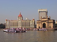 A view of the hotel with the Gateway of India, as seen from the Arabian Sea