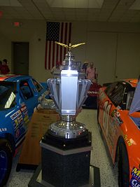 The winner of the Brickyard 400 is presented with the PPG Trophy in victory lane.