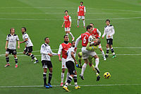 Arsenal against rivals Tottenham, known as the North London derby, in November 2010