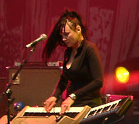 Natasha Shneider recorded with the band, providing keyboards and piano. Schneider subsequently appeared on Songs for the Deaf, performing on three of the album's tracks, and joined the band as a full member in 2005 during the Lullabies to Paralyze tour.