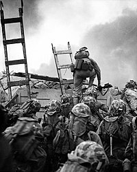 American Marines climbing a sea wall in Incheon during a decisive moment in the timeline of the Korean War