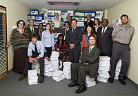 The Office starring cast at the beginning of the third season. From left to right: Phyllis Lapin-Vance, Toby Flenderson, Jim Halpert (seated), Oscar Martinez, Pam Beesly, Angela Martin, Kelly Kapoor (seated), Ryan Howard, Creed Bratton, Michael Scott, Meredith Palmer, Kevin Malone, Dwight Schrute (seated), Jan Levinson, Stanley Hudson, and Roy Anderson.