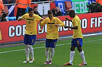 Neymar celebrates his goal for Brazil against Scotland, on 27 March 2011, with André Santos and Ramires