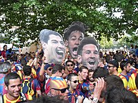 Barcelona fans prior to the 2015 UEFA Champions League Final in Berlin holding up pictures of the attacking trio, Messi, Suárez and Neymar (MSN)