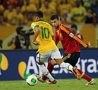 Neymar playing against Spain's Gerard Piqué in the 2013 FIFA Confederations Cup Final